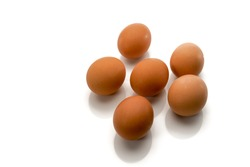 Eggs isolated on white background, six brown chicken eggs, half a dozen in top view, text space