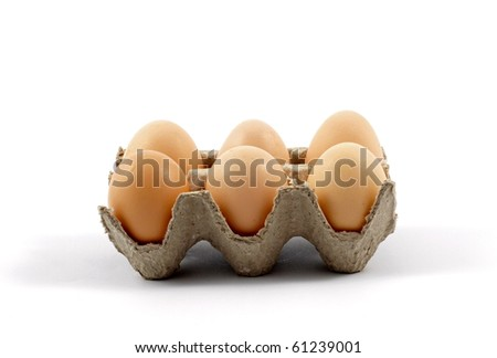 Eggs on a tray against white background
