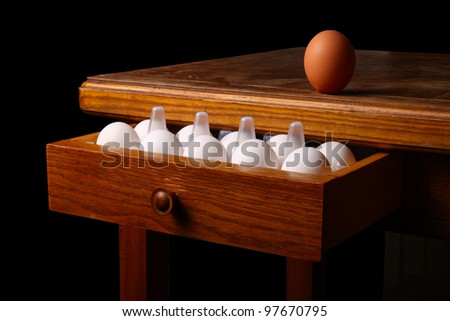 eggs on old table. isolated on black