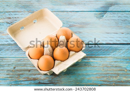 eggs pack on wood background