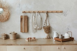 Eggs packing and other kitchen utensils on the kitchen table. Rustic kitchen interior