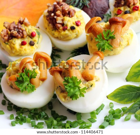 Eggs stuffed with boiled egg yolk, fried onions and mushrooms
