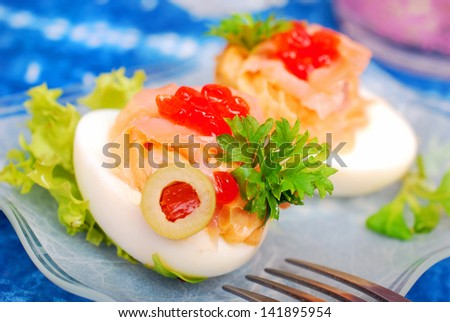 eggs stuffed with smoked salmon and red caviar as appetizer