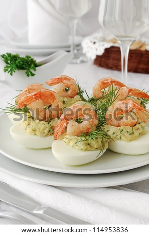 eggs stuffed with spicy stuffing with grilled shrimp
