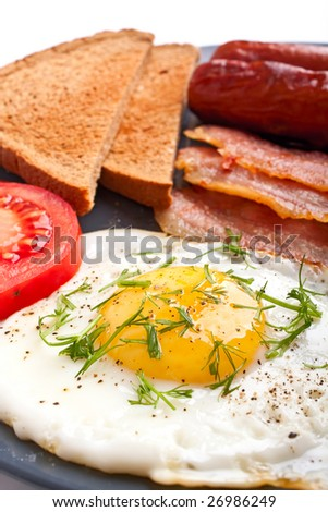 eggs, toasts, sausages and bacon - stock photo