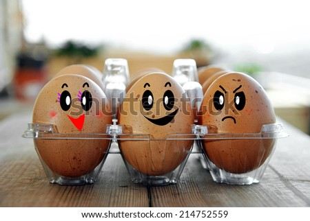 eggs tucked in its box on a wooden table