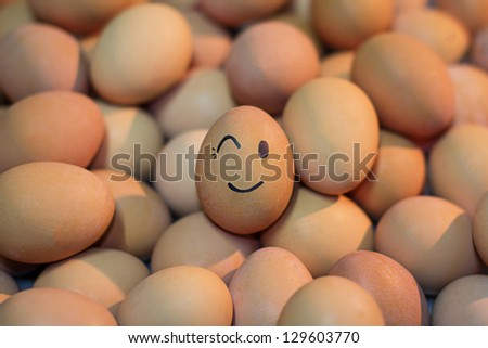 Eggs with wink face on sunset light