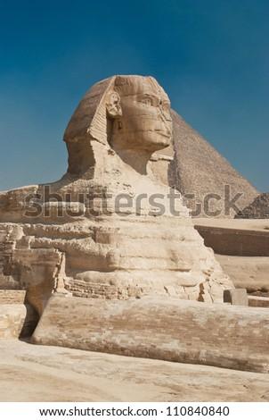 egiptian sphinx in desert near old pyramid