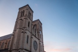 Eglise Saint Jean Baptiste Church at dusk in Bourgoin Jallieu, France, a city of Dauphine region, in Isere Departement. It is the main catholic church of this city, built in the 19th century