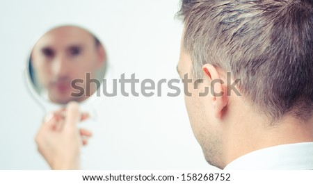ego man reflection in mirror on a white background #158268752