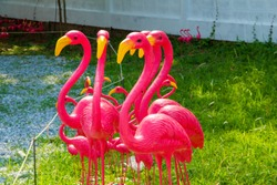 Egret statue,Pink heron statue in the lawn,Sculpture of pink bittern in the Garden.