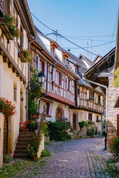 Eguisheim, Alsace, France, Traditional colorful halt-timbered houses in Eguisheim Old Town on Alsace Wine Route, France.colorful streets old town