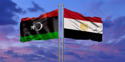 Egypt and Libya flag waving in the wind against white cloudy blue sky together. Diplomacy concept, international relations.