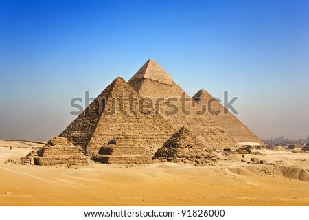 Egypt. Cairo - Giza. General view of pyramids from the Giza Plateau (in order from left: the Pyramid of Menkaure /Mykerinos/, Khafre /Chephren/ and Chufu /Cheops/ - known as the Great Pyramid
