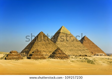 Egypt. Cairo - Giza. General view of pyramids from the Giza Plateau (three pyramids known as Queens' Pyramids, in background: the Pyramid of Menkaure /Mykerinos/, Khafre /Chephren/ and Chufu /Cheops/)