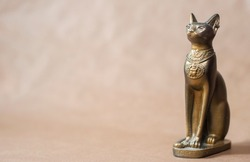 egypt cat statuette on solid background