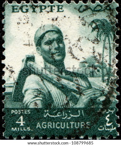 EGYPT - CIRCA 193: A stamp printed in Egypt shows peasant with a hoe on his shoulder, circa 1953