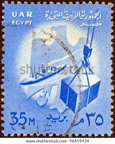 EGYPT - CIRCA 1958: A stamp printed in Egypt shows ship and crate on hoist and Egypt emblem, circa 1958.