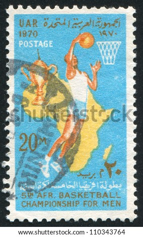 EGYPT - CIRCA 1970: stamp printed by Egypt, shows Basketball player, map of Africa, Cup, Basket, ball, circa 1970 - stock photo