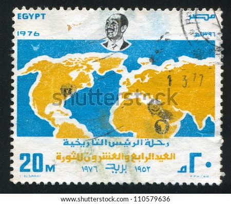 EGYPT - CIRCA 1976: stamp printed by Egypt, shows World map, Anwar Sadat portrait, emblem, circa 1976
