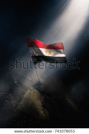 Egypt flag standing with triumph after a disaster. #741078055