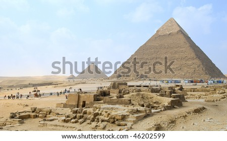 egypt, landscape with three pyramids and tourist under blue sky