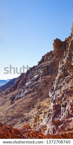 Egypt. Mount Sinai in the morning at sunrise. (Mount Horeb, Gabal Musa, Moses Mount). Pilgrimage place and famous touristic destination. Bedouins, camels and tourists.