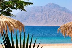 Egypt Nuweiba - beach with mountains at Reds sea