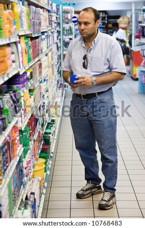 Egyptian adult man shopping in the supermarket,