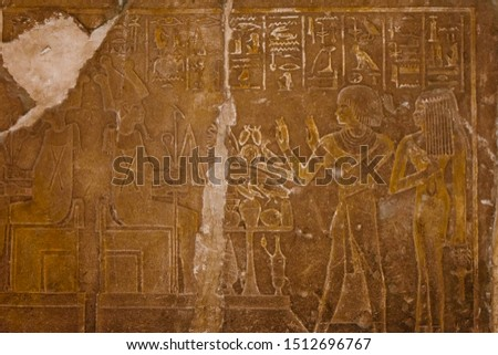 Egyptian ancient pictures on a stone wall