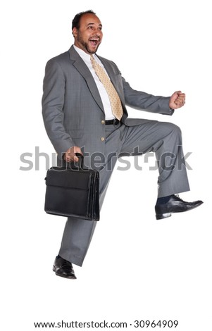Egyptian, Arabic man in a business suit with suitcase really happy