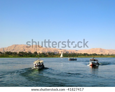 Egyptian boats with tourists on the river nile near luxor egypt
