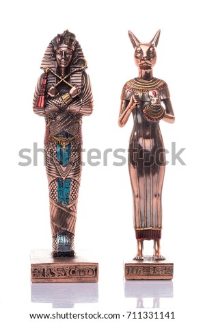 Egyptian cats and pharaon on a white background. Egyptian pharaoh Statue Stock photo ©