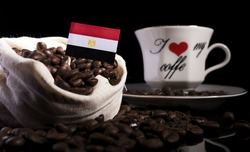 Egyptian flag in a bag with coffee beans isolated on black background