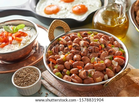 Egyptian food fava beans with Flafel and pickled