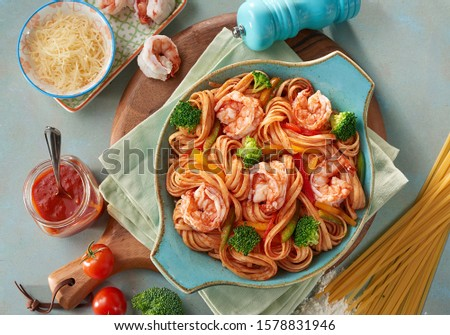 Egyptian food pasta with shrimp and sausage slices and meat