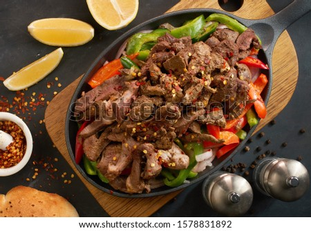Egyptian food roasted liver with tomato