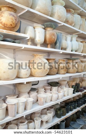 egyptian hand made stone jugs on counter at souvenir shop