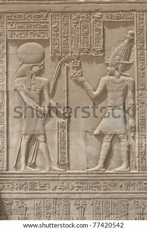 Egyptian hieroglyphic carvings on a wall at the Temple of Kom Ombo