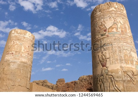 Egyptian hieroglyphs and drawings on the walls and columns. Egyptian language, The life of ancient gods and people in hieroglyphics and drawings #1244569465