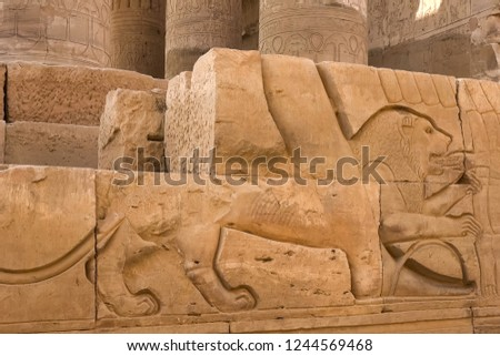 Egyptian hieroglyphs and drawings on the walls and columns. Egyptian language, The life of ancient gods and people in hieroglyphics and drawings #1244569468