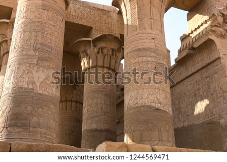 Egyptian hieroglyphs and drawings on the walls and columns. Egyptian language, The life of ancient gods and people in hieroglyphics and drawings #1244569471