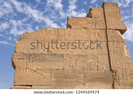 Egyptian hieroglyphs and drawings on the walls and columns. Egyptian language, The life of ancient gods and people in hieroglyphics and drawings #1244569474