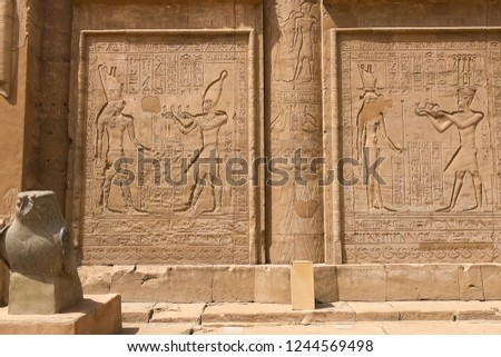 Egyptian hieroglyphs and drawings on the walls and columns. Egyptian language, The life of ancient gods and people in hieroglyphics and drawings #1244569498