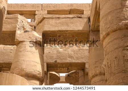 Egyptian hieroglyphs and drawings on the walls and columns. Egyptian language, The life of ancient gods and people in hieroglyphics and drawings #1244573491