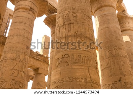 Egyptian hieroglyphs and drawings on the walls and columns. Egyptian language, The life of ancient gods and people in hieroglyphics and drawings #1244573494