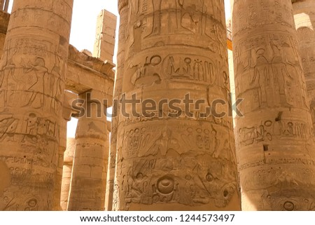 Egyptian hieroglyphs and drawings on the walls and columns. Egyptian language, The life of ancient gods and people in hieroglyphics and drawings #1244573497