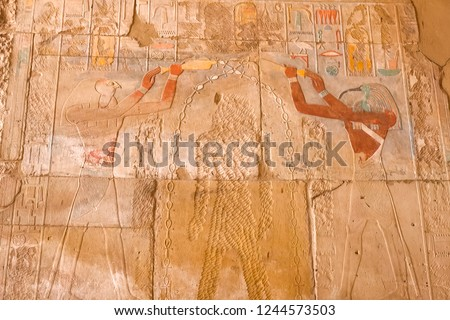 Egyptian hieroglyphs and drawings on the walls and columns. Egyptian language, The life of ancient gods and people in hieroglyphics and drawings #1244573503