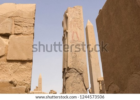 Egyptian hieroglyphs and drawings on the walls and columns. Egyptian language, The life of ancient gods and people in hieroglyphics and drawings #1244573506