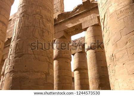 Egyptian hieroglyphs and drawings on the walls and columns. Egyptian language, The life of ancient gods and people in hieroglyphics and drawings #1244573530